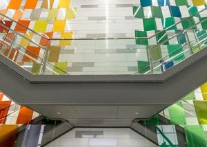 Colored laminated glass from GlasPro on staircase with checkered wall behind