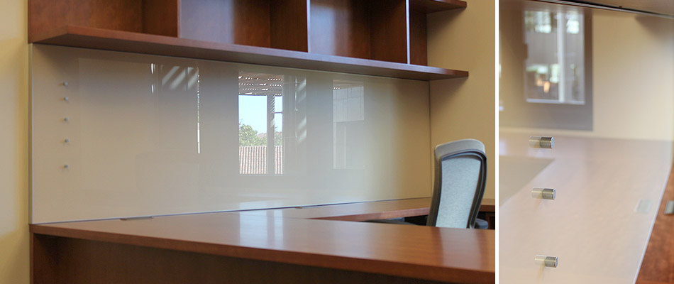 magnetic glass whiteboard at an office desk