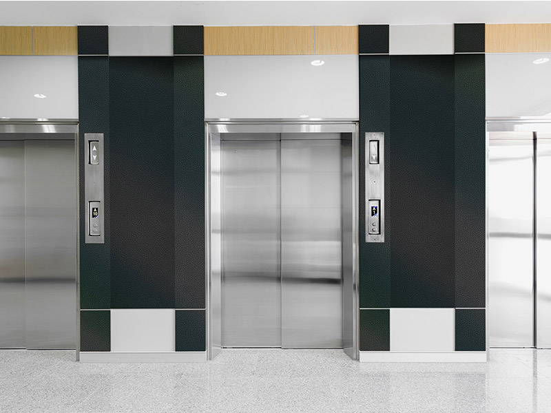 surface products ATI NuMetal 1014 NEP Neptune Polished Smoke Elevator Lobby